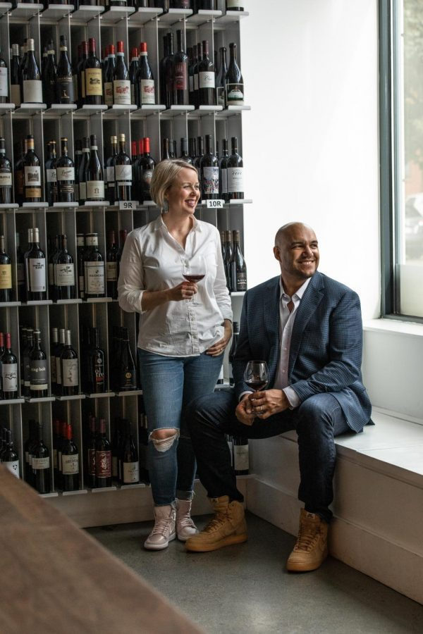 TJ and Hadley Douglas pictured in front of a wine rack at The Urban Grape