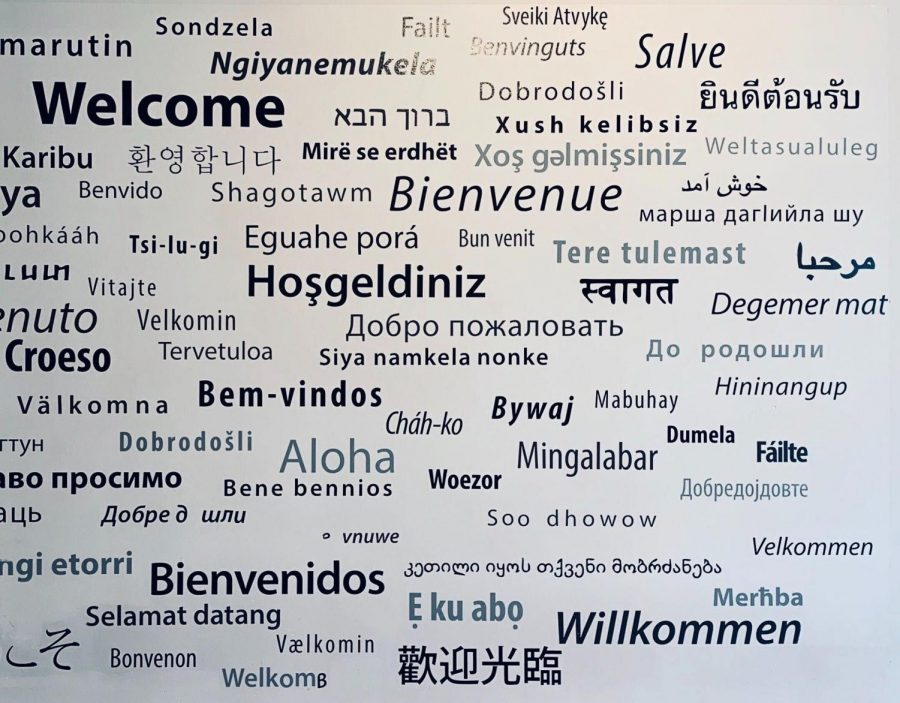 A wall in the Office of Global Services depicting a greeting in numerous languages.