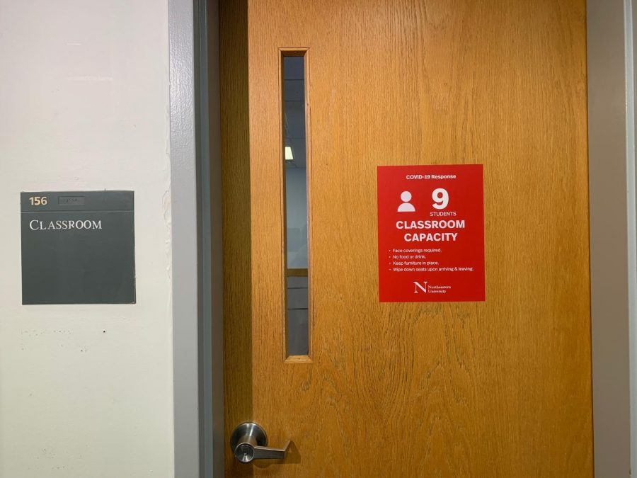Classrooms across the Northeastern campus have their capacity marked at the door.