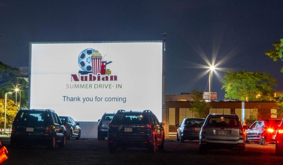Cars+parked+in+front+of+the+screen+at+the+Nubian+Summer+Drive-in.+