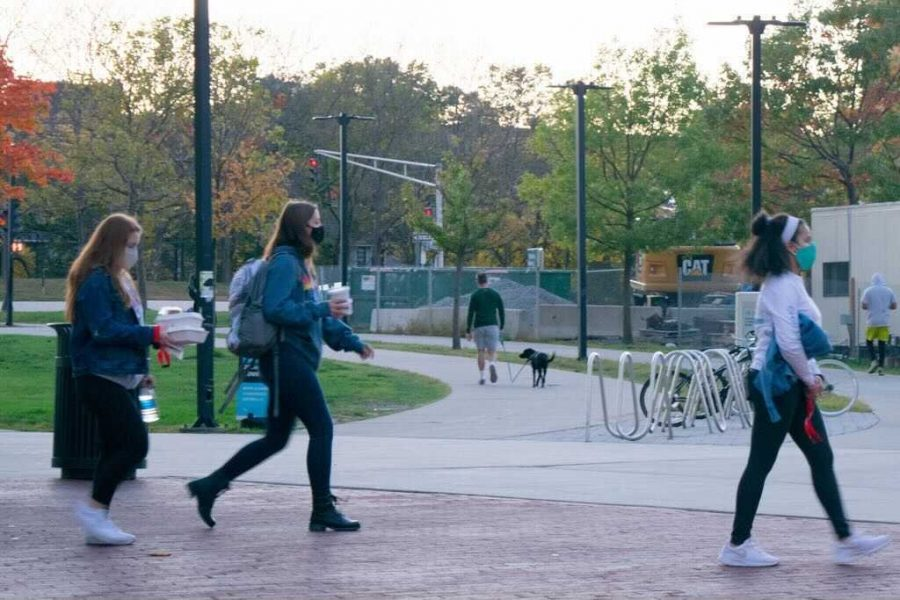 "Students leave International Village Dining with ""grab 'n go"" meals."