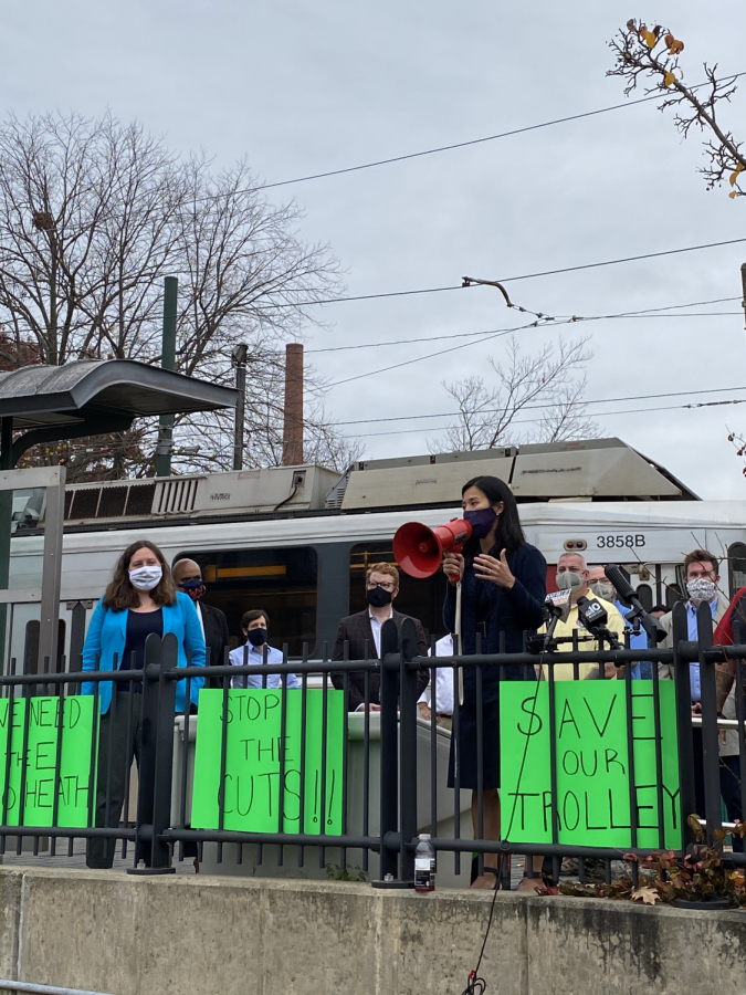 Boston+City+Councilor+Michelle+Wu+speaks+to+protestors+rallying+against+the+MBTA+service+cuts+that+were+proposed+Nov.+9.