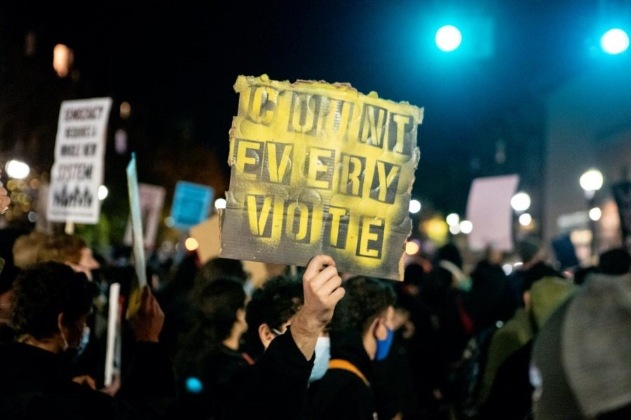 Protestors amassed in Roxbury's Nubian Square on Wednesday evening to demand that all votes in the 2020 presidential election be counted. Many denounced the American election system, and they urged others to not be complacent. The rally began with speeches before marching to Copley Square later in the evening.