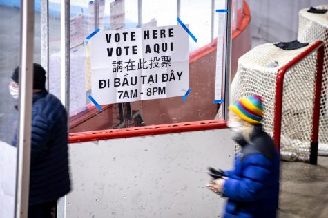 Northeastern community members wait in line to vote at Matthews Arena on Election Day.