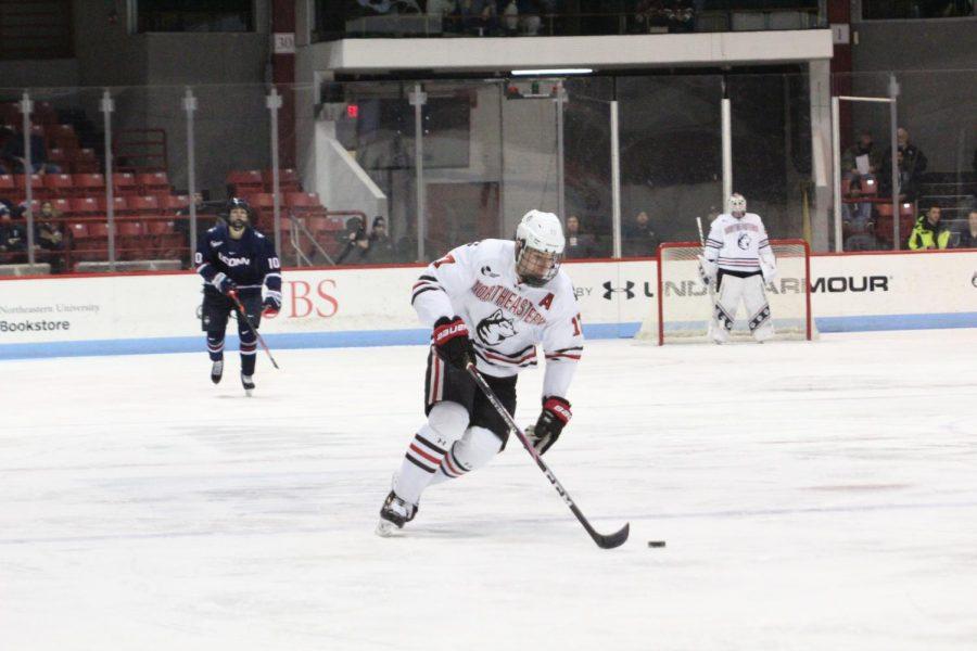 Matt Filipe skates the puck to the opposing net in a game against UConn last season in January.