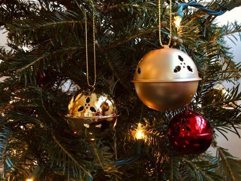 Ornaments adorn a Christmas tree.
