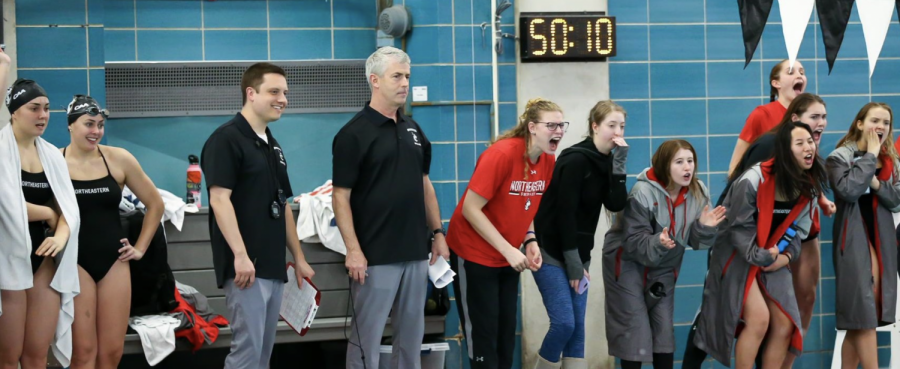 Coach Coates (center-left) has coached Northeastern's swim and dive team for 28 years.