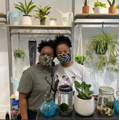 Quontay Turner and Danita Mends pose for a picture at the Northeastern Valentine's Day Marketplace Feb. 11.  Turner and Mends cofounded the Emerald City Plant Shop, one of the local small businesses at the Valentine