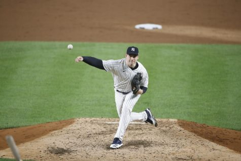 Adam Ottavino, former New York Yankees player and Northeastern baseball alum, returns to Boston to join the Red Sox.