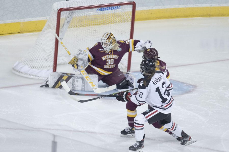 The Northeastern Huskies narrowly claimed victory on the road to the national championships in overtime, 3-2, against the Minnesota Duluth Bulldogs Thursday afternoon.