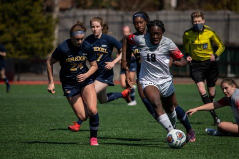 Senior forward Chelsea Domond dribbles past the Drexel Dragons in a game earlier this season.