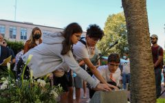 During the event Sept. 11, attendees placed roses and small commemorative stones on the memorial. The event also featured several speakers and a moment of silence for the victims of 9/11.