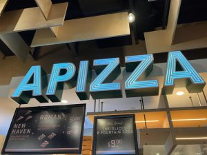 The APIZZA sign hangs in Hub Hall